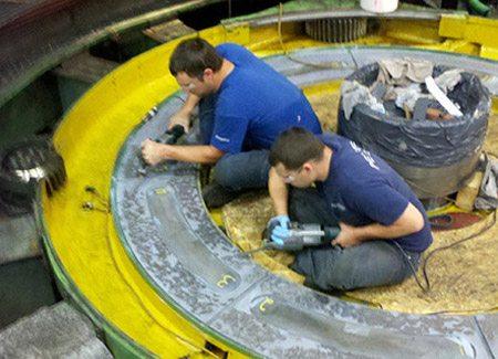 Two technician performing emergency field repair.