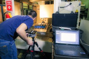 4. Adjusting the position of the laser to align the optics.
