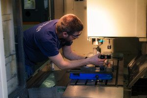 5. Adjusting the optics inside the machine for proper alignment.
